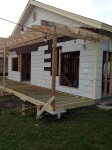 Late-March - porch progress; more civilized ways to enter the store.
